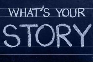 "Teksti ""What's your story"" liitutaululla."